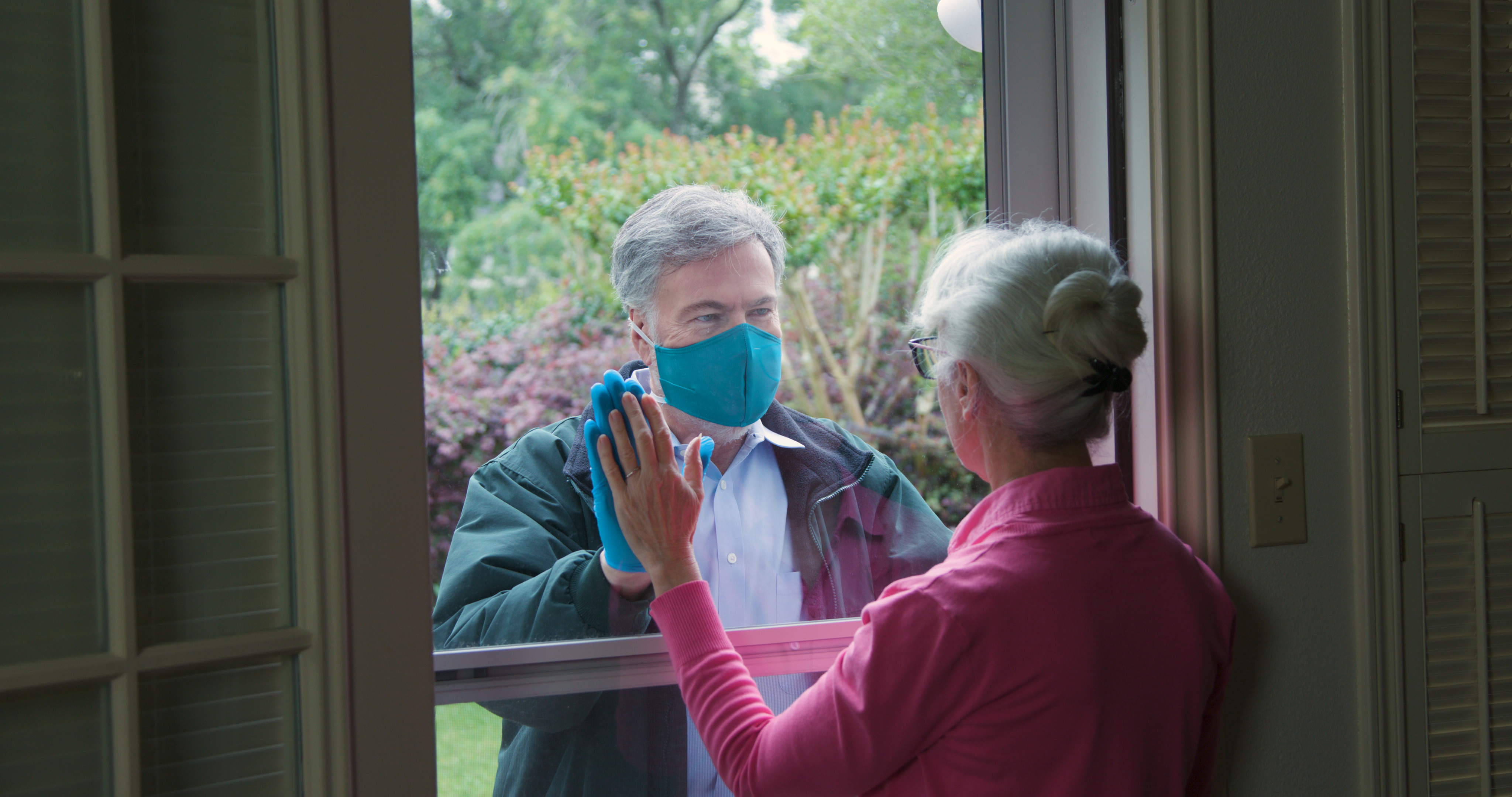 man checks on older neighbour during COVID-19 pandemic
